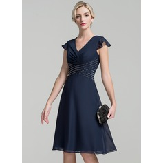 A-Line/Princess V-neck Knee-Length Chiffon Mother of the Bride Dress With Ruffle Beading Sequins